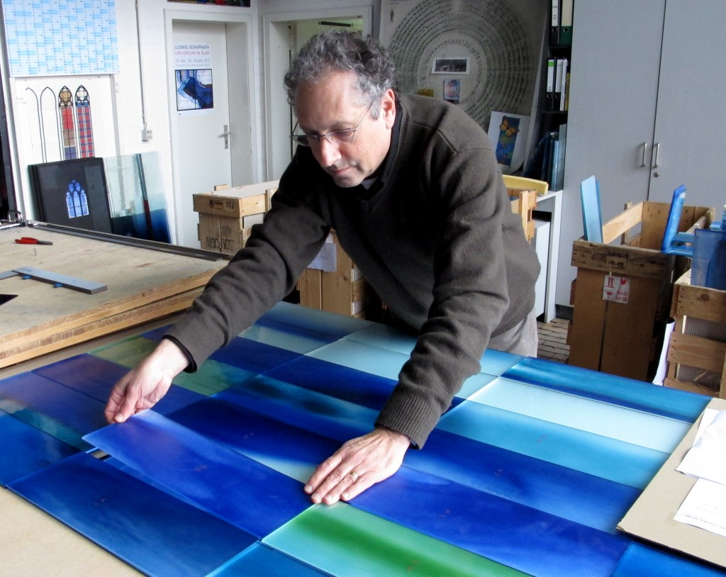 Paul Housberg working on glass art installation.